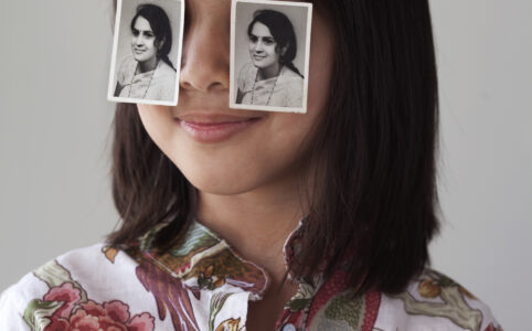 Image of child in foreground with two black and white images over their eyes.